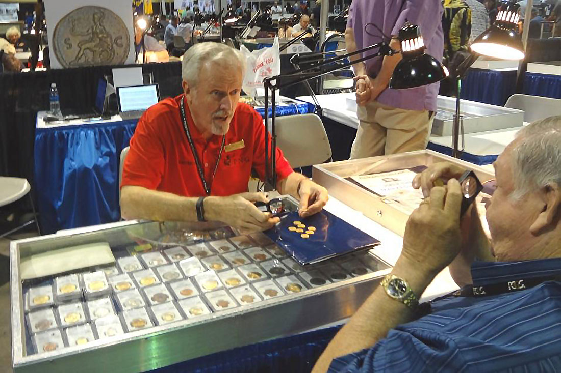 Don Ketterling is a fixture at major coin shows. Here he discusses the hot coins on the market with another coin dealer.